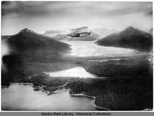 Navy_biplane_flying_over_Mendenhall_Glacier_Juneau_1926